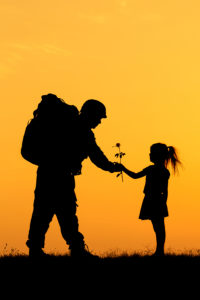 soldier and girl silhouette on the orange bacground